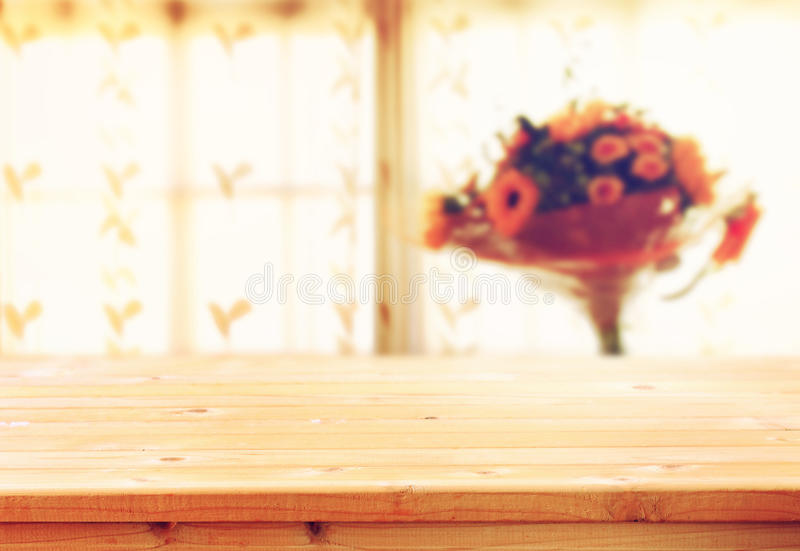 Empty wooden table and window light background filtered image natural light stock photo