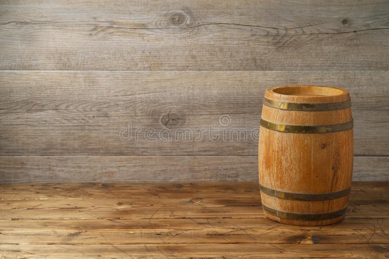Empty wooden table with wine barrel over wooden board background. Empty wooden table with wine barrel over wooden background stock images