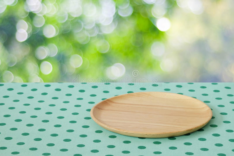 Empty Wooden Tray On Table Over Blur Trees With Bokeh