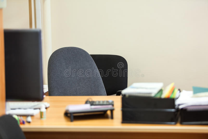 Empty working place with chair and pc monitor on table. Empty working place with chair and pc monitor on desk royalty free stock photos