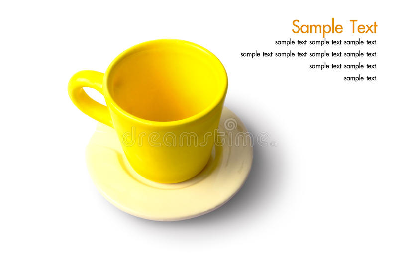 An empty yellow cup with plate. On isolated stock image