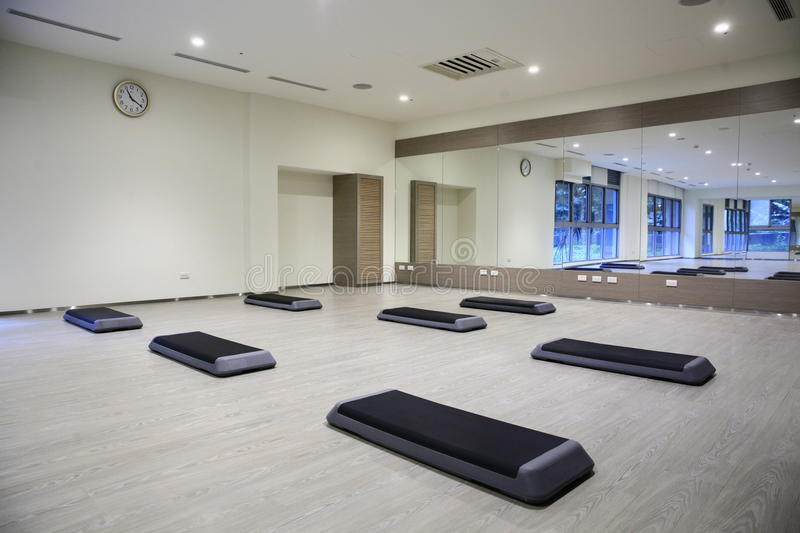 Empty yoga classroom. Mat of floor of empty yoga classroom with mirror covered wall stock images