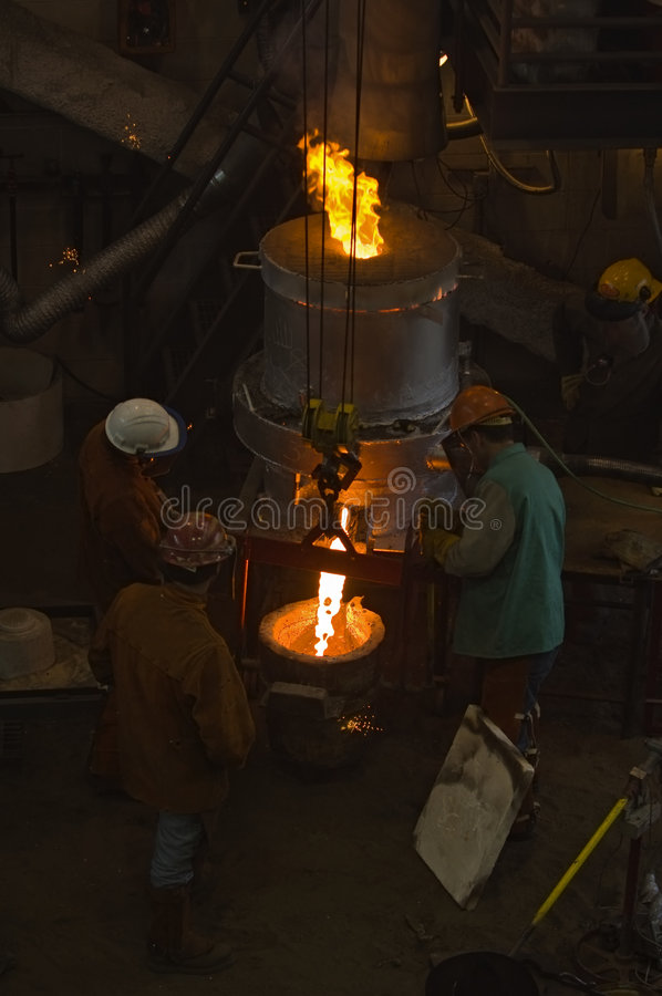 Emptying the Furnace - Focus on Ladle stock image