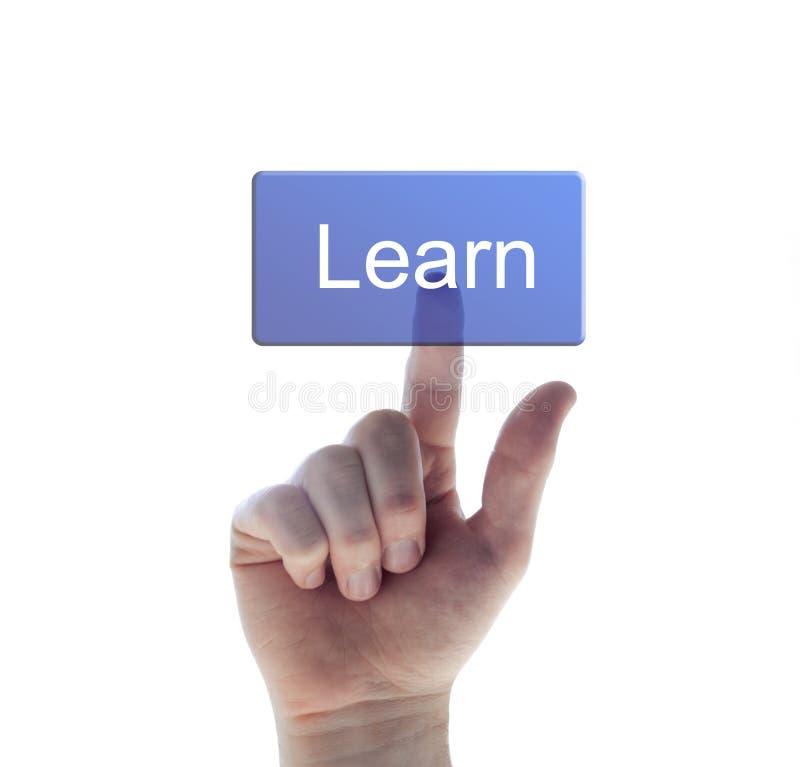 Empujar el botón del aprendizaje manualmente foto de archivo
