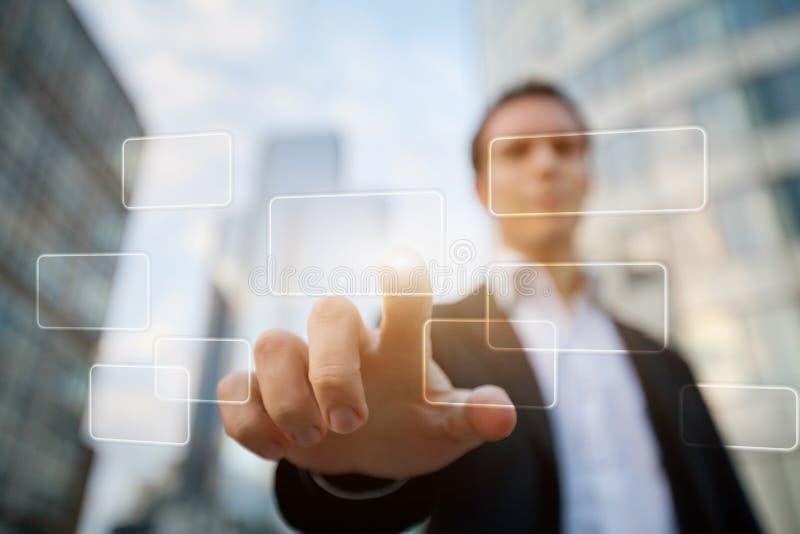 Empurrando o botão em uma relação do ecrã táctil imagens de stock royalty free