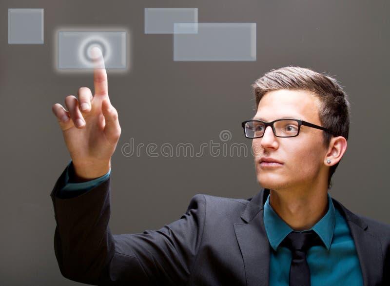 Empurrando uma tecla em um mundo digital imagem de stock