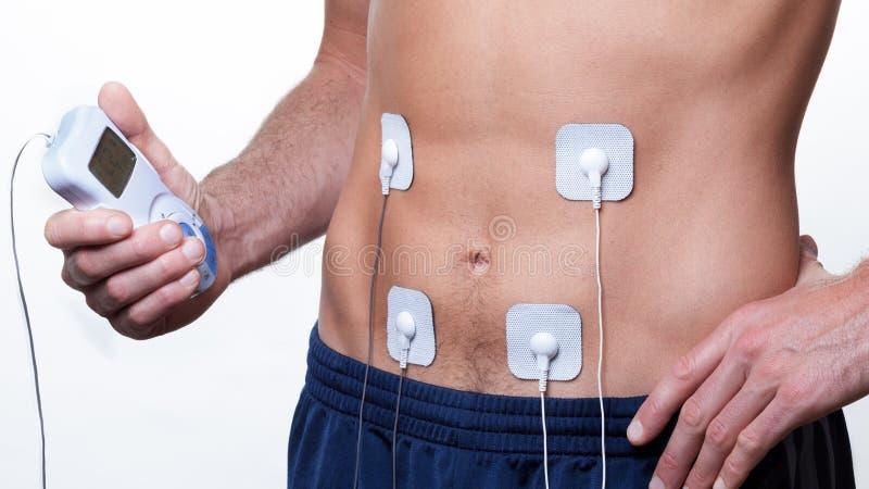 Ems тренируя электрическое стимулирование мышцы стоковые фотографии rf
