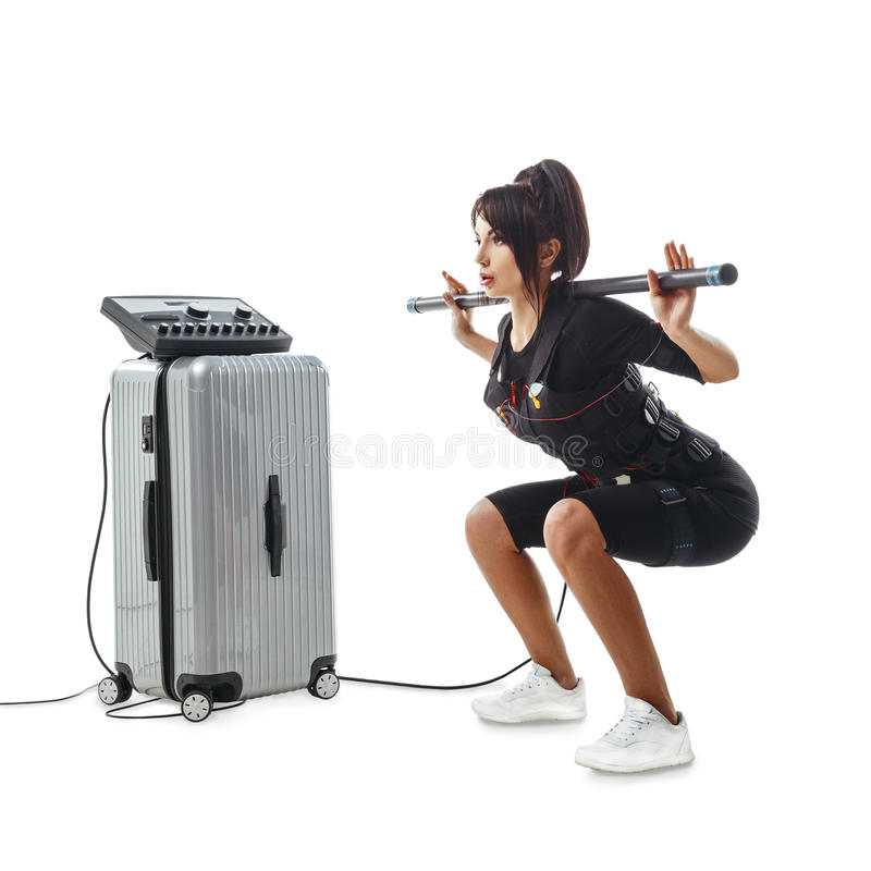 EMS fitness woman. Squatting exercise with body bar royalty free stock photos