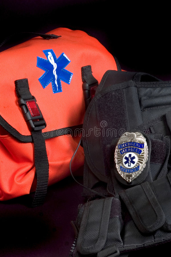 EMT medical bag, tactical vest and badge. EMT medical bag with Life Star , tactical vest and EMS shield badge stock image