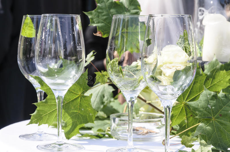 Emty Glasses. Party table with wine glasses and floral decoration royalty free stock photo
