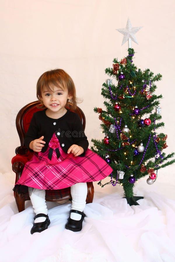 En årig jullitet barnflicka royaltyfri fotografi