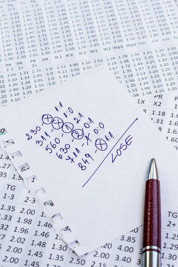 En anmärkning med förloravalet av de segra koderna på bookmaker fotografering för bildbyråer
