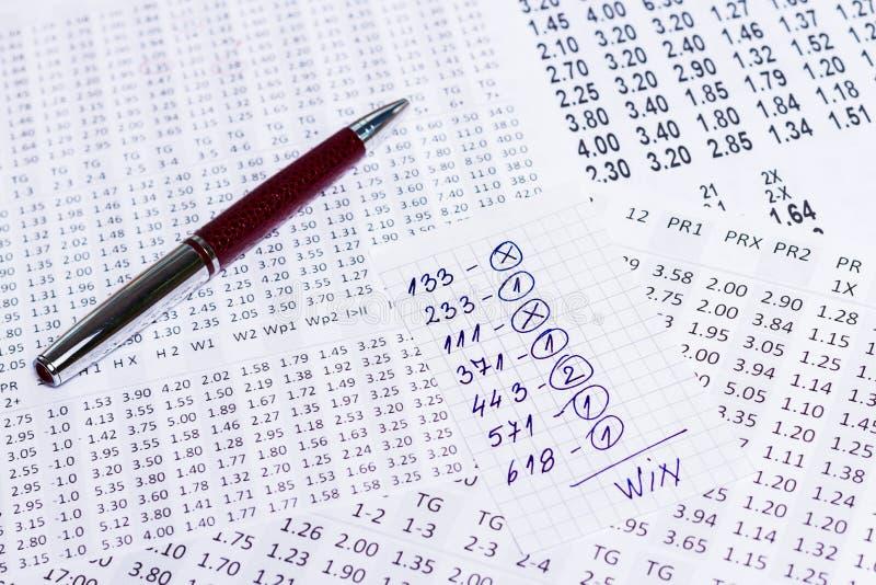 En anmärkning med segervalet av de segra koderna på bookmaker royaltyfri foto