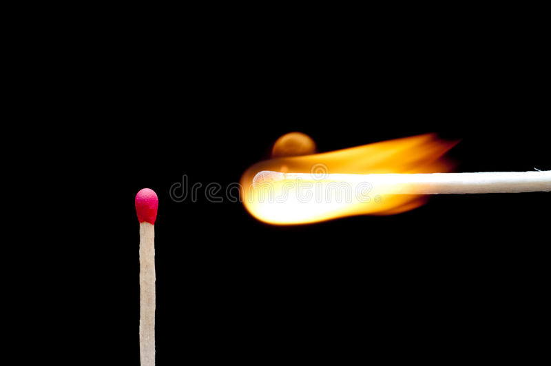 en annan burning match nära arkivbild