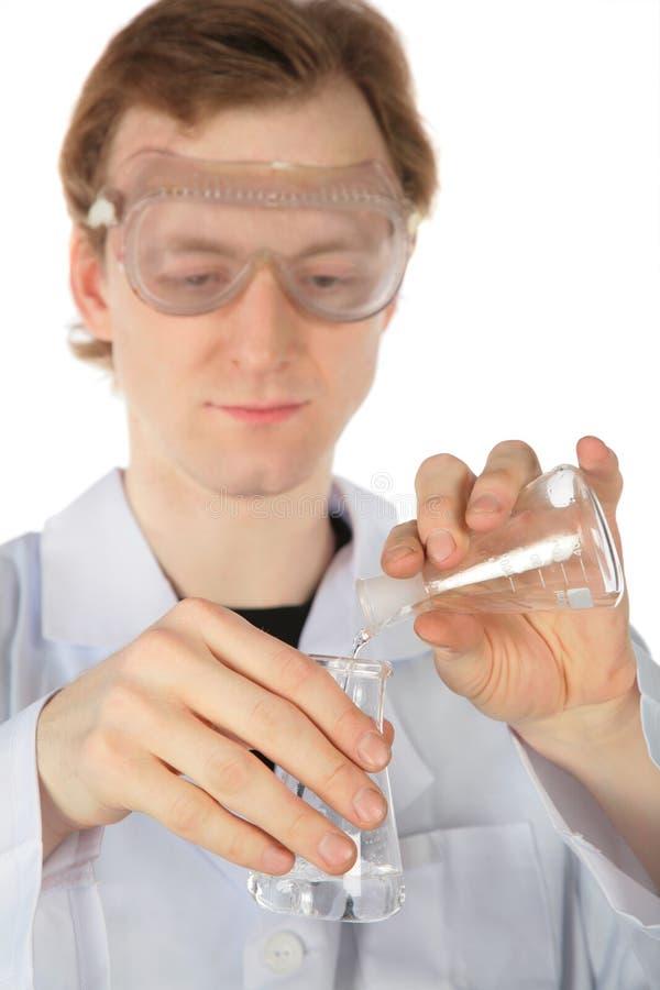 en annan kemistflaskaflytande häller royaltyfri foto