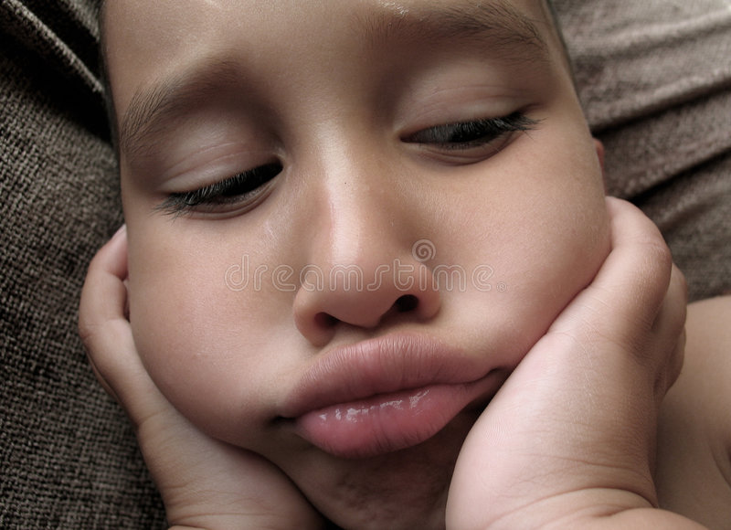 en annan SAD pojke royaltyfri foto