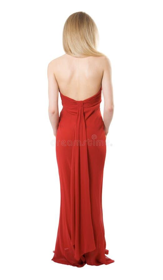 En arrière de la fille mince dans une robe de soirée image libre de droits
