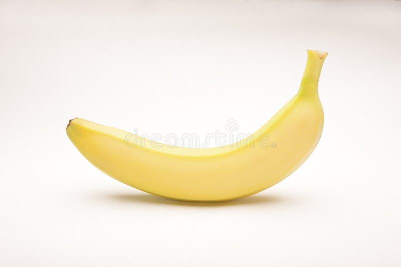 En banan som isoleras på vit fotografering för bildbyråer