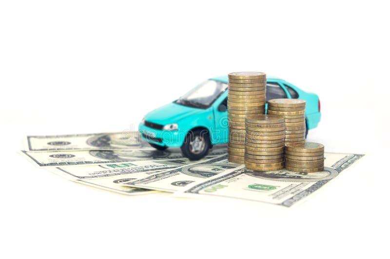 En blå bil med mynt royaltyfria bilder