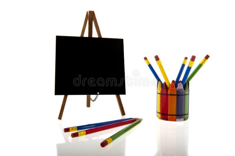 Blackboarden och colourfull ritar royaltyfri bild
