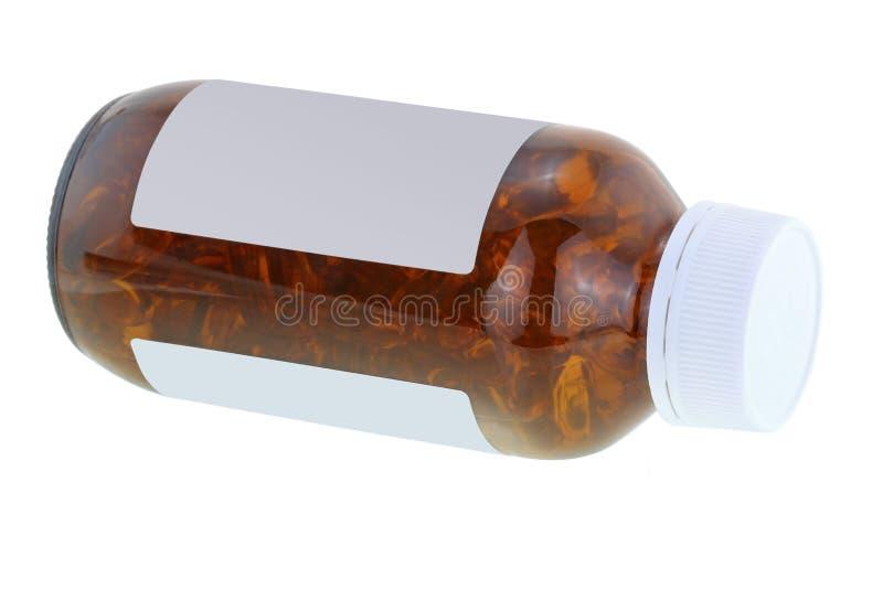 En brun medicinflaska av fiskolja i mjukt stelnar mycket kapslar royaltyfri foto