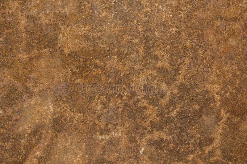 En brun orange rostig arkmetall Textur för grov yttersida arkivbilder