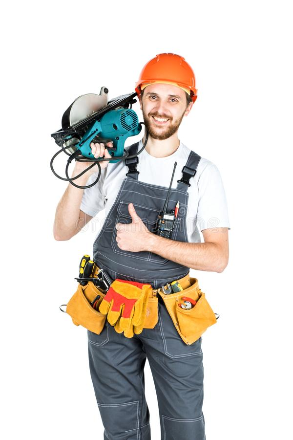 En byggmästare eller anställd i en skyddande hjälm med en elkraft fotografering för bildbyråer