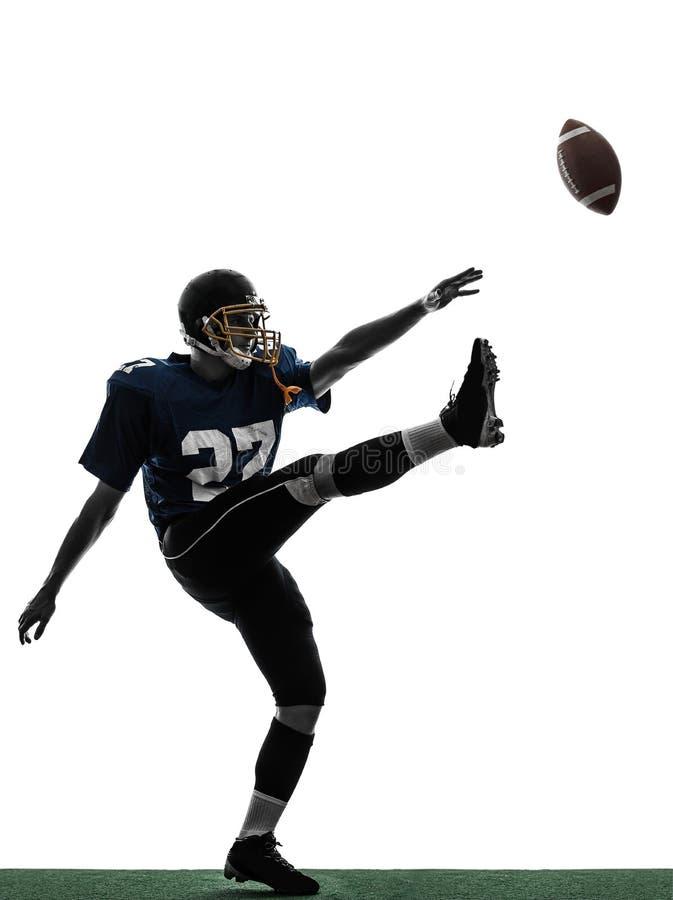Silhouette för kicker för amerikanfotbollsspelareman sparka arkivbilder