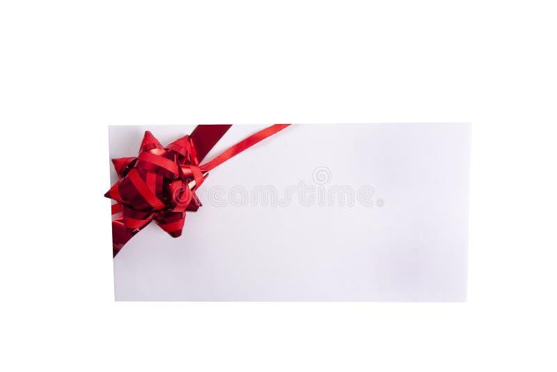 En cinta con el regalo en blanco foto de archivo libre de regalías