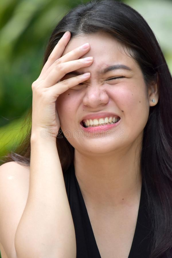 En Contemplative Bevacful Filipina Female Woman royaltyfri foto