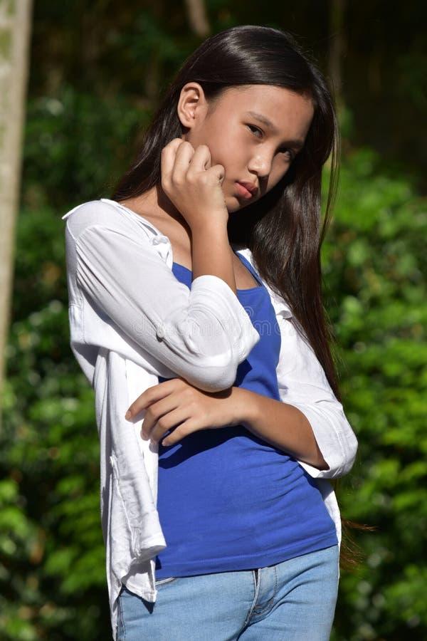 En Contemplative Teenager Girl arkivfoto