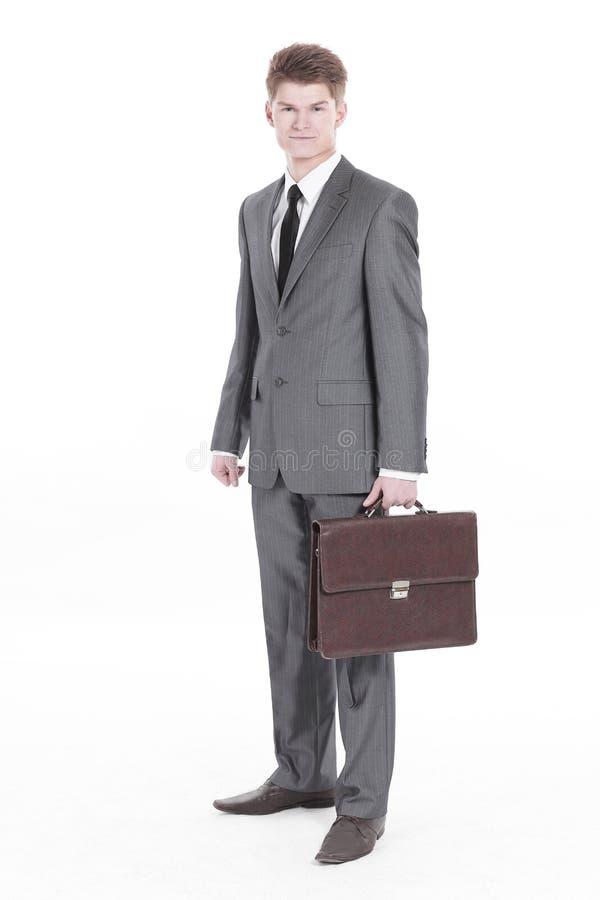 En crecimiento completo Hombre de negocios joven con una cartera de cuero imagen de archivo