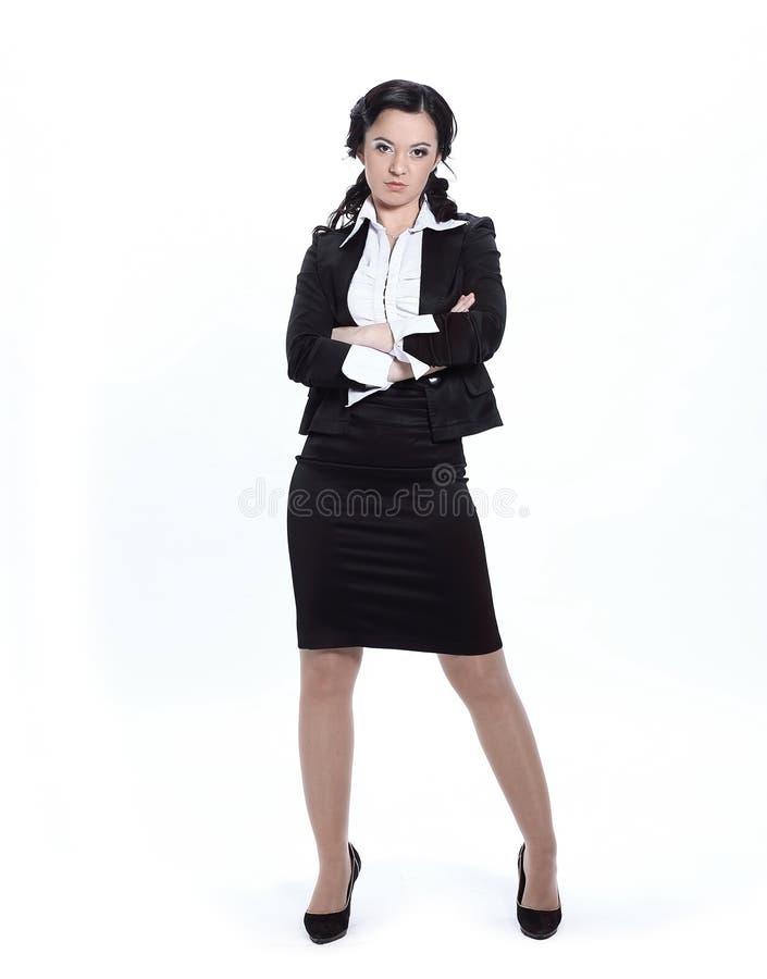 En crecimiento completo Mujer de negocios seria Aislado en blanco foto de archivo