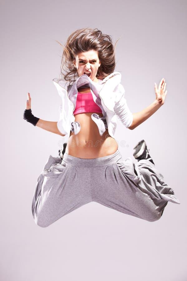 En danser die van de vrouw gilt de springt royalty-vrije stock afbeelding