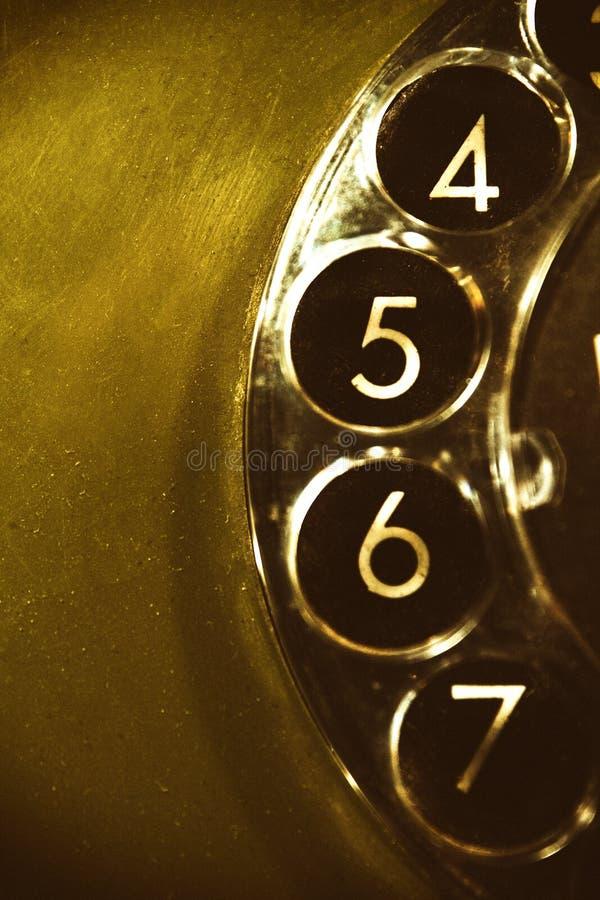 En del av en roterande visartavla av en gammal telefon royaltyfri foto