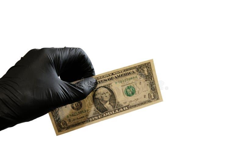 En dollar USA i vänstersidahanden av en man i en svart rubber handske bakgrund isolerad white kopiera avstånd royaltyfri foto
