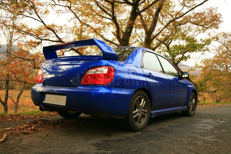En el camino - Subaru Impreza el coche japonés del funcionamiento fotografía de archivo libre de regalías
