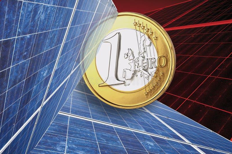 En euromynt och solpanel mot röd bakgrund, slut upp royaltyfri bild
