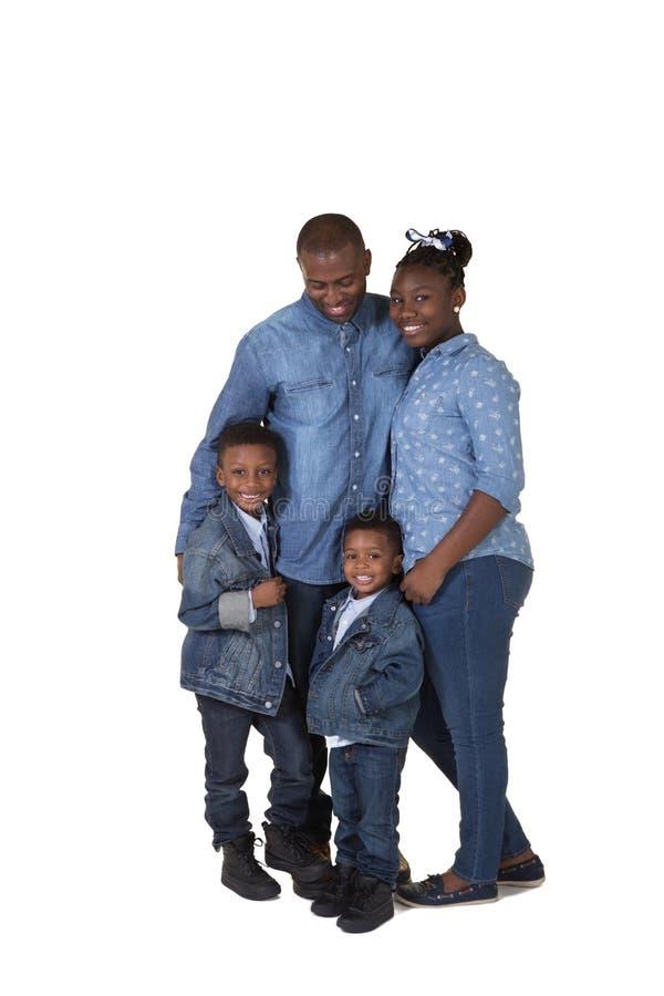 En fader och hans 3 barn arkivfoto