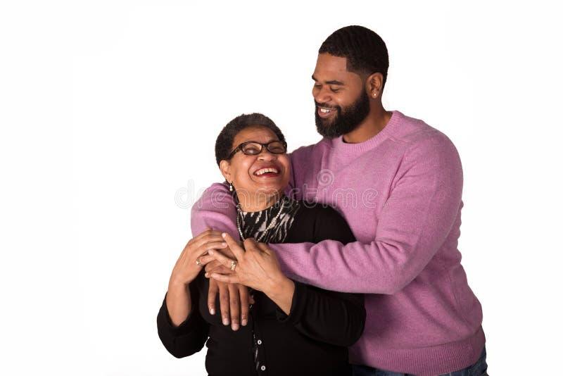 En farmor och hennes fullvuxna son arkivbilder