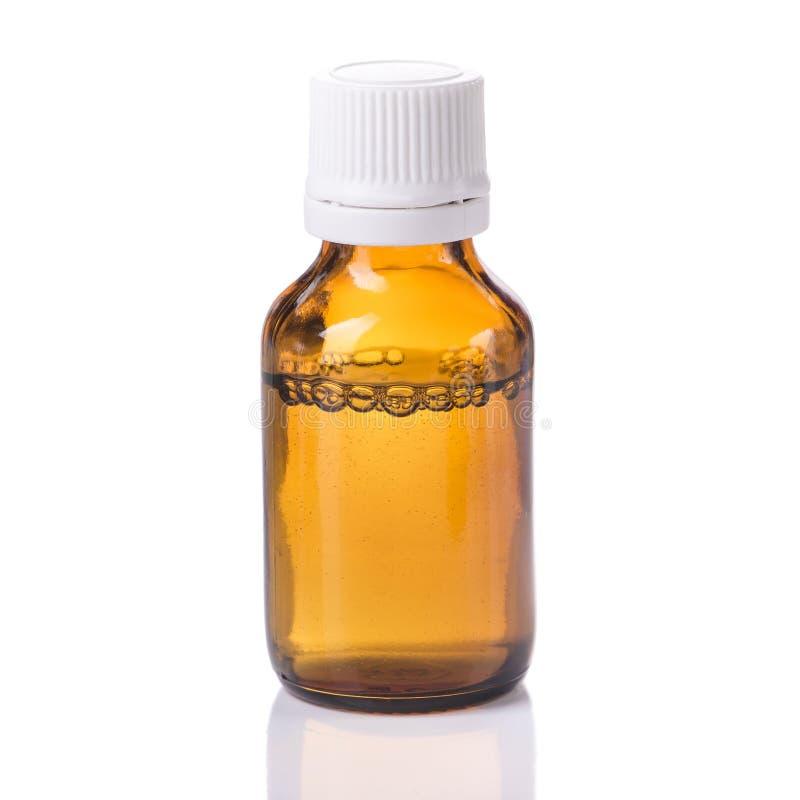 En flaska med vätskemedicin arkivfoton