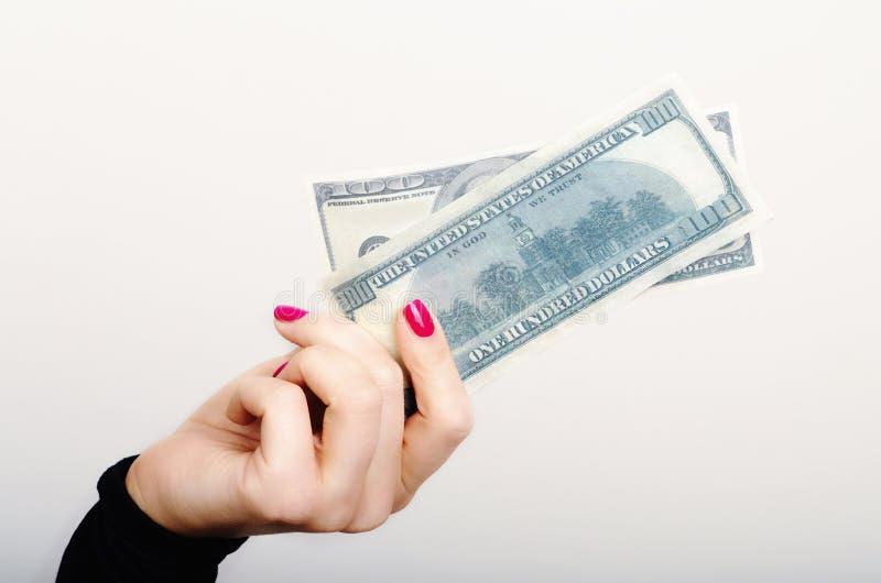 En flicka med pengar royaltyfria bilder
