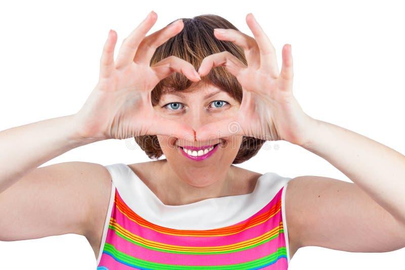 En flicka visar en hjärta - jag älskar all dig! royaltyfri fotografi