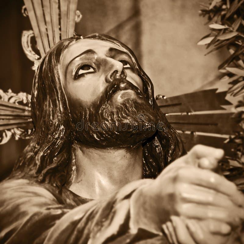 Jesus Kristus som ber i trädgården av Gethsemane royaltyfri bild