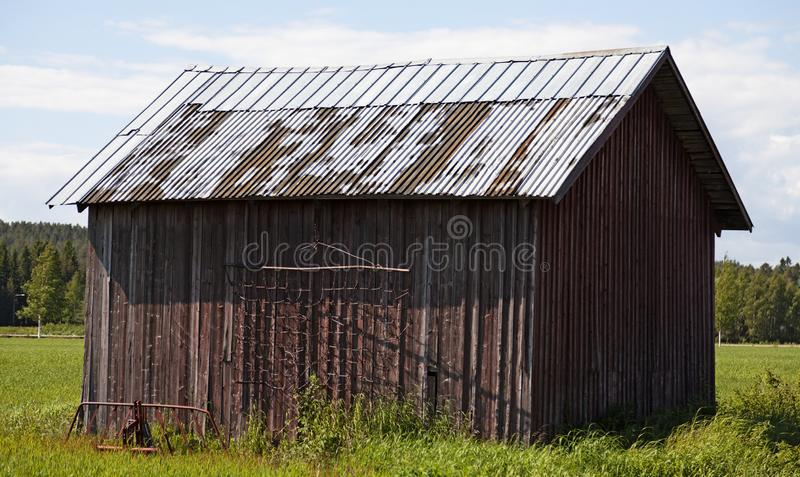 En gammal ladugård på slätten av Roback royaltyfri foto