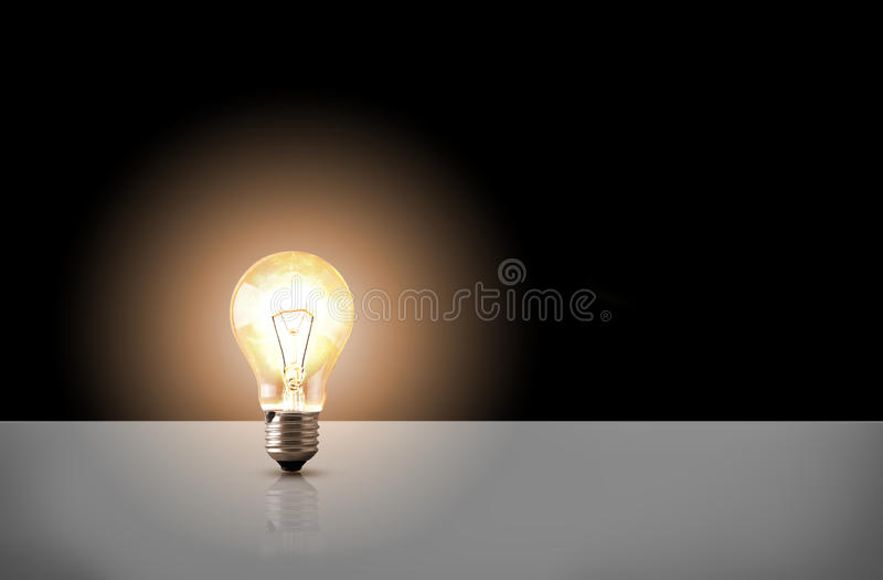 En glödande ljus kula på svart bakgrund vektor illustrationer
