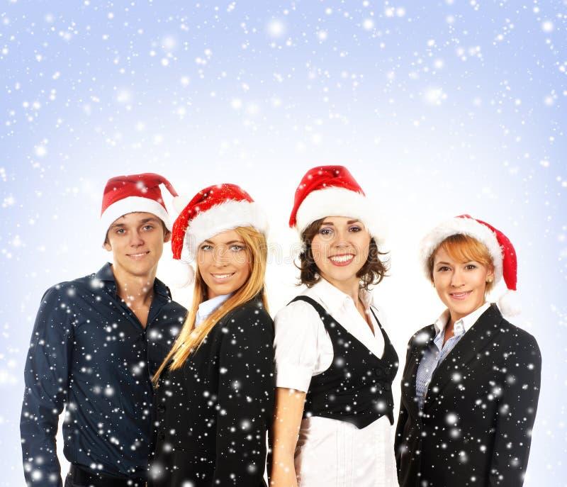 En grupp av affärspersoner i julhattar fotografering för bildbyråer