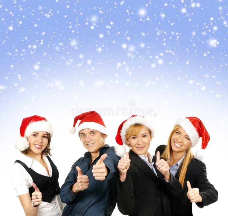 En grupp av affärspersoner i julhattar royaltyfri bild