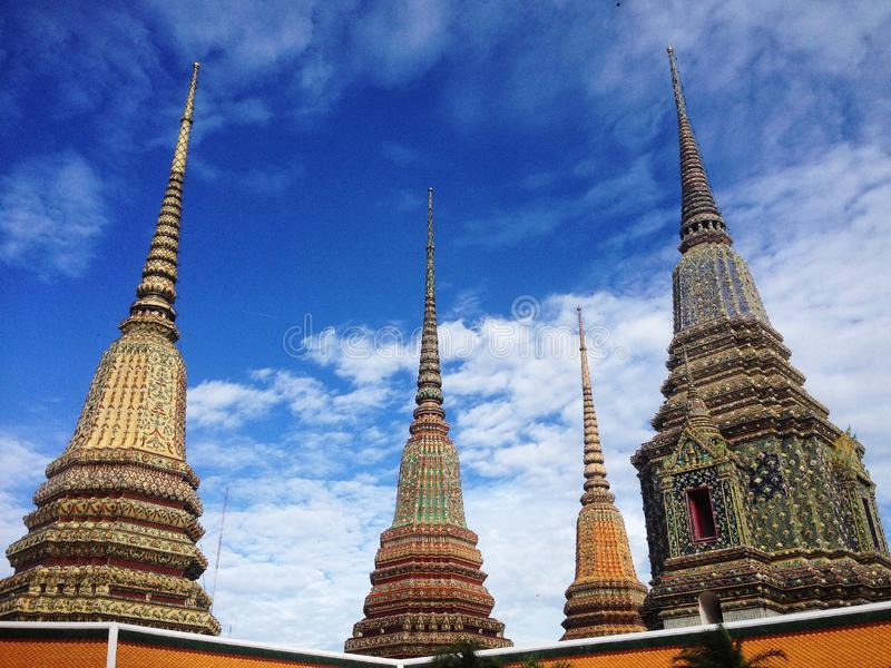 En grupp av fyra pagoder i Wat Pho, Bangkok royaltyfri foto