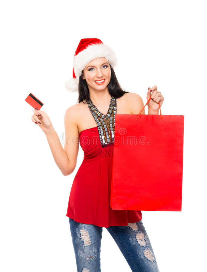 En härlig julshoppareflicka med en kreditkort royaltyfria foton